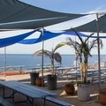 Shaded seating at Cliffhanger Cafe.- Torrey Pines Gliderport