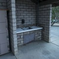 Restroom and shower facilities with a wash station at Hermit Gulch Campground.- Hermit Gulch Campground