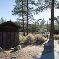 Vault toilet at Meadow Group Campground.- Meadow Group Campground