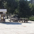 Vault toilet and picnic tables at Devils Canyon Trailhead.- Devils Canyon Trail Hike