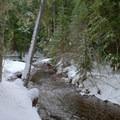 Snowy river banks along Salt Creek.- Salt Creek Falls + Diamond Creek Falls Snowshoe