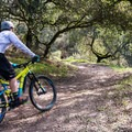 Bike rider on the La Corona Trail. - La Corona Trail Hike