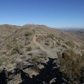 The Pyramid Trail traverses a ridge toward Telegraph Pass. Mount Suppoa (2,690 ft) is in the distance.- Pyramid Trail Hike