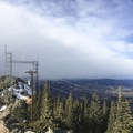 Telecommunication towers at the top of Squaw Mountain. Longs Peak is obscured by cloud cover.- Squaw Mountain Snowshoe