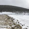 Earthen berm around the reservoir.- Lefthand Park Reservoir Snowshoe