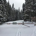 Gate blocking the four-wheel drive road and trail.- Lefthand Park Reservoir Snowshoe