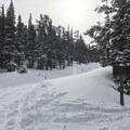 Trail splits; stay right.- Lefthand Park Reservoir Snowshoe
