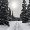 Sun peeking through snow clouds.- Lefthand Park Reservoir Snowshoe