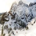 Hikers exploring the area below.- Castle Dome Snowshoe