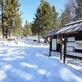 Donner Lake Rim Trail informational kiosk marks the trailhead.- Donner Ridge Snowshoe via Johnson Canyon