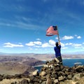After signing the register, make sure to let Old Glory fly atop the summit of Fortification Hill. An old American flag has been left near the summit register and USGS marker.- Fortification Hill Hike