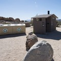 Vault toilet and recycling at White Tank Campground.- White Tank Campground