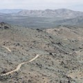 View looking down the Lost Horse Road (now the Lost Horse Mine Trail) from the mine.- Lost Horse Loop Trail