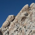 Climbers at the top of one of Indian Cove's many crags.- Indian Cove Campground