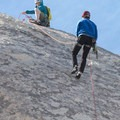 Climber rappelling down Huevos on Intersection Rock's north face.- Intersection Rock - Climbing Crag