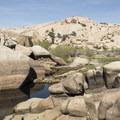 Water behind the dam.- Barker Dam Trail