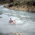 Enjoying the Boiling River Hot Springs in Yellowstone National Park.- Boiling River Hot Springs