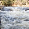 Several smaller rapids lead into the falls.- Auger Falls