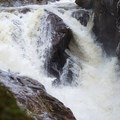 The best views of the falls are on a steep slope, so be careful not to fall in.- Auger Falls