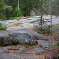 A bedrock outcropping is an alternative place to picnic- Buttermilk Falls