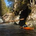 A paddler leaves the pool below Fallopian.- Middlebury Gorge Kayaking