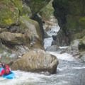 Dropping into the lead in of Cunnilingus with the entrance to Rebirth below.- Middlebury Gorge Kayaking