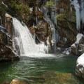 Emerald pools and overhanging rocks make Bingham Falls a magical destination.- Bingham Falls