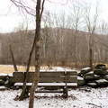 Benches are located along the trail.- Mills Riverside Park