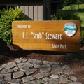 Welcome sign at the visitor center.- L.L. Stub Stewart State Park Mountain Bike Trails: Freeride + XC Loop
