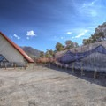 Ichthyosaur fossil parking area with a life-size painting.- Berlin-Ichthyosaur State Park