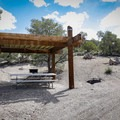 Each campsite has a covered picnic bench, fire pit and grill.- Berlin-Ichthyosaur State Park Campground
