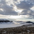 The sun setting over Lamar Valley in Yellowstone National Park.- Lamar Valley