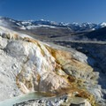 Small waterfalls can be seen in the Mammoth Hot Springs complex.- Mammoth Hot Springs