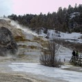 Steam rising from Mammoth Hot Springs in Yellowstone National Park.- Mammoth Hot Springs