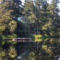 The lodge and rental boats at the resort.- San Juan Island: Lake Dale Resort + Campground