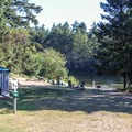 The day use beach area on Dream Lake.- San Juan Island: Lake Dale Resort + Campground