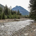 The river boundary of the campground is just beyond the group sites.- Wallowa Lake State Park Campground