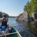 Massive chunks of bedrock line the Eagle Reservoir.- Beaver River Canoe Trail