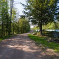The Eagle Falls portage follows a dirt road.- Beaver River Canoe Trail