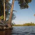 The perfect rope swing awaits on an island at Soft Maple Reservoir.- Beaver River Canoe Trail