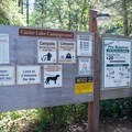 Information sign for Carter Lake Campground in the Oregon Dunes National Recreation Area.- Carter Lake Campground