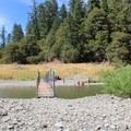 The access trail crosses the river via a foot bridge.- Standish-Hickey SRA Swimming Hole