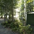 Vault toilet at Bear Creek Recreation Site Campground.- Bear Creek Recreation Site Campground