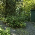 Vault toilet at Tamihi Rapids Recreation Site Campground.- Tamihi Rapids Recreation Site Campground