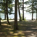 Day use picnic area and beach at Sunnyside Campground.- Sunnyside Campground