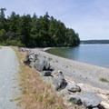 Private property on either side of the gravel access road.- Kukutali Preserve (Kiket Island)