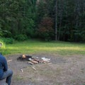 A typical campsite with a picnic table and a fire ring.- Beauty Creek Campground
