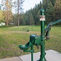 A pump to get potable water at Beauty Creek Campground.- Beauty Creek Campground