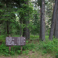 Signage with distances to Beaver Bay Beach from the trailhead at Whitetail Campground.- Beaver Bay Shoreline Trail