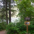 A picnic area along the trail with views of Lake Pend Oreille.- Beaver Bay Shoreline Trail
